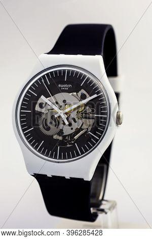 London, Gb 07.10.2020 - Swatch Swiss Made Quartz Watch On White Backdrop. Plastic Case Open Clock Me
