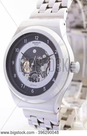 London, Gb 07.10.2020 - Swatch Swiss Made Mechanical Watch On Stand Close Up. Metal Case Open Clock