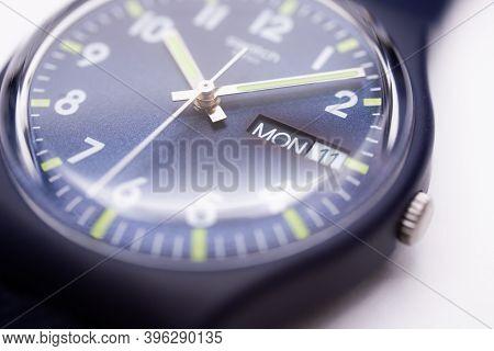 Geneve, Switzerland 07.10.2020 - Swatch Swiss Logo On Blue Wristwatch Dial Of Swiss Made Mechanical