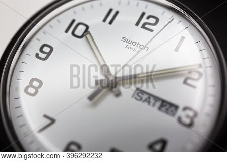Geneve, Switzerland 07.10.2020 - Swatch Swiss Logo On White Wristwatch Dial Of Swiss Made Mechanical