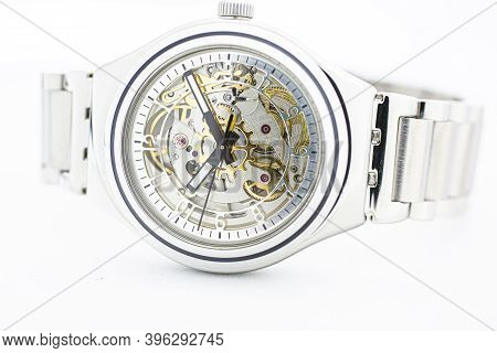London, Gb 07.10.2020 - Swatch Swiss Made Mechanical Watch Close Up On White Backdrop. Metal Case Op