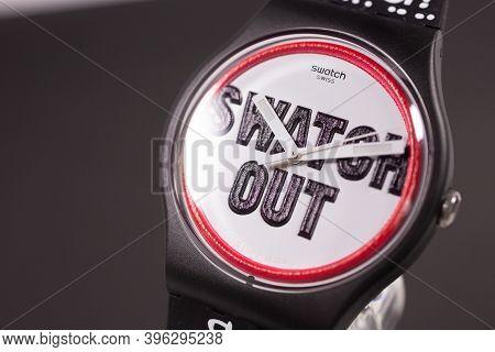 New York, Ny, Usa 07.10.2020 - Swatch Childrens Trendy Swiss Made Quartz Watch Isolated On Black Bac