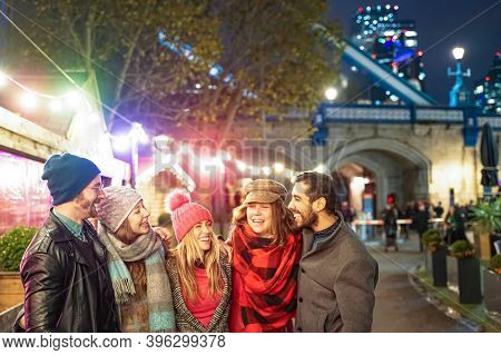 Happy Group Of Friends Walking In London Street . Young People Hanging Out Ready For Christmas Night