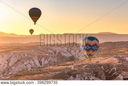 Hot Air Balloon Flying Over Cappadocia Region, Goreme, Turkey. Great Tourist Attraction - Sunrise Ba