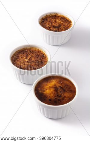 Homemade Creme Brulee In Bowl Isolated On White Background