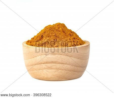 Dry Turmeric Powder Or Curcuma Longa Linn In Wooden Bowl Isolated On White Background.