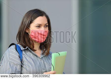 Student Wearing Mask To Avoid Coronavirus Contagion Walking In The Street