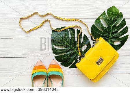 Fashion Bag And Shoe Woman Accessories Wood White Background. Trendy Fashion Luxury Yellow Handbag,