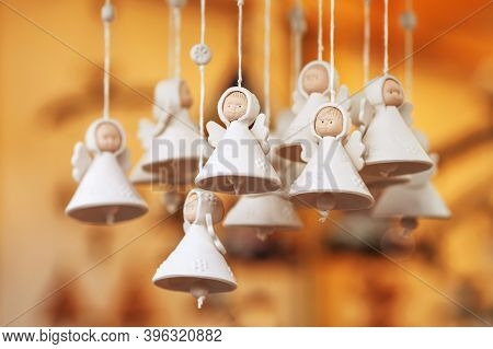 Colorful Ceramic Bells And Other Decorations Sold On Christmas Market In Europe. Bell Clay Souvenir