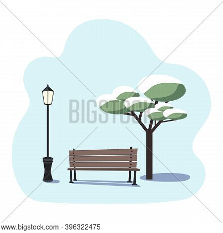 Winter Urban Landscape - An Empty Park Bench, A Tree In The Snow And A Street Lamp On A Blue Backgro
