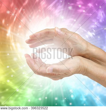 Colour Therapy Healing Hands Concept - Female Hands With Bright White Healing Energy Between Against