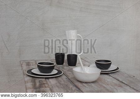 Ceramic Kitchenware, Ceramic Water Jug, A Ceramic Mug, And A Ceramic Plate.
