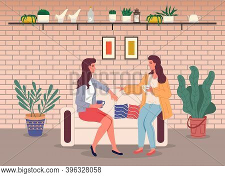 Brunette Women Girls Sitting At Sofa And Talking. Friends Relaxing With Cup Of Tea Or Coffee. Happy