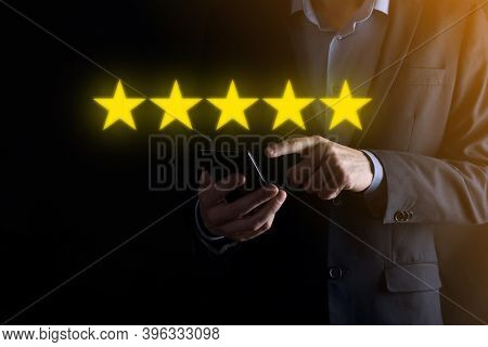 Man Hand Smartphone Showing On Five Star Excellent Rating.pointing Five Star Symbol To Increase Rati