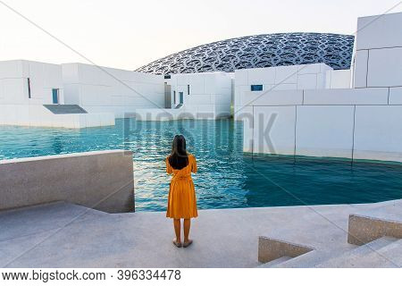 Abu Dhabi, United Arab Emirates - November 30, 2019: Female Traveler Taking Photos At Louvre Museum
