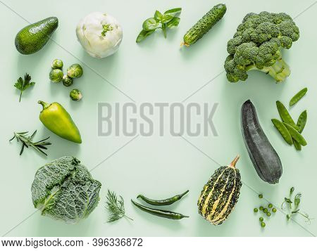 Green Monochrome Flat Lay Composition With Vegetables, Copy Space In Center. Vegetables - Green Peas