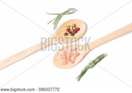Isolated Herbs In Spoon. Various Spices Pepper, Himalayan Salt, Rosemary In Wooden Spoons On White B