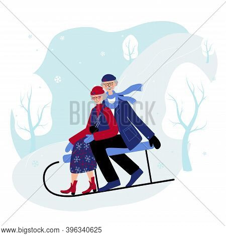 Seniors Couple Slide Down The Hill On The Sleigh. Old People Spend Winter Days Outdoors In The Open