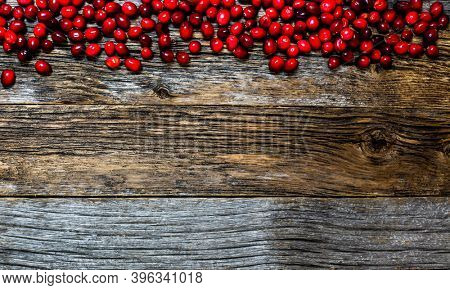 Cranberry on weathered wooden table