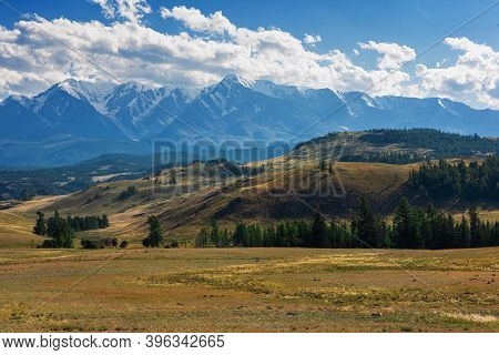 Kurai steppe and North-Chui ridge on background. Altai mountains, Russia.