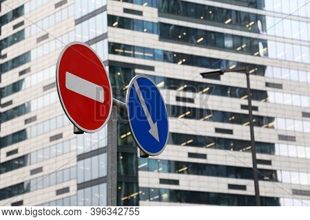 No Entry Sign And Detour Obstacles Sign On The Skyscraper Background. Concept Of Economic Sanctions,