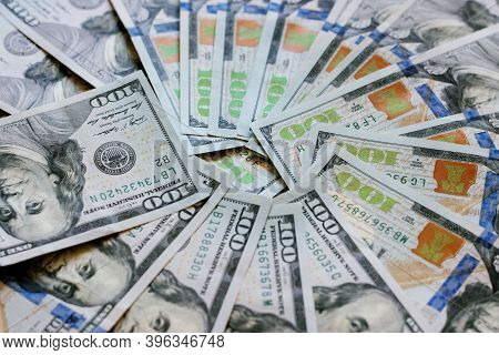 Background Of Hundred-dollar Bills, The Texture Of Dollars. A Stack Of Hundred Dollar Bills Spread O