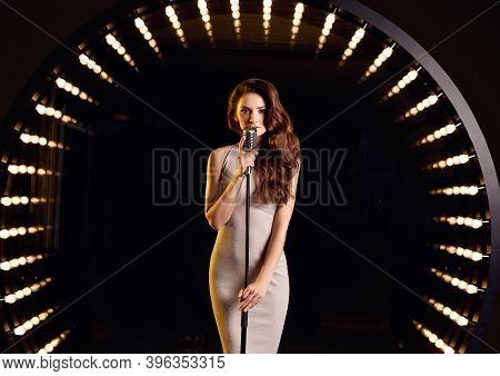 Gorgeous Singer Woman In With Retro Microphone On Restaurant Stage