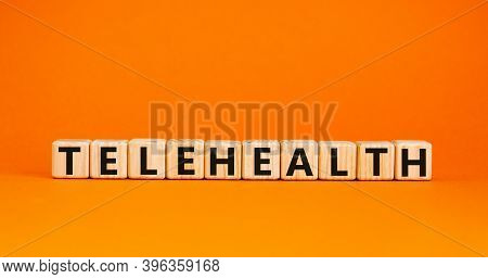 Time To Telehealth. Wooden Cubes With The Word 'telehealth'. Beautiful Orange Background, Copy Space