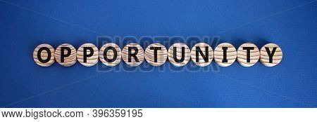 Time To Opportunity. Wooden Circles With The Word 'opportunity'. Beautiful Blue Background, Copy Spa