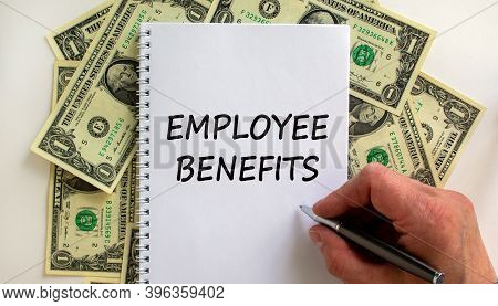Employee Benefits. Male Hand Writing 'employee Benefits' On White Note, On White Background. Dollar