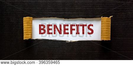 Time To Benefits. The Word 'benefits' Appearing Behind Torn Black Paper. Business And Benefits Conce