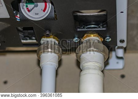 Engineering Heating Systems For Houses. Close-up Of Gas Boiler Piping Nodes With Ball Valves And Pre