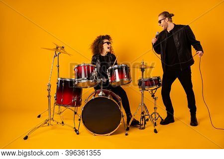 Full Body Photo Of Famous Rock Group Cool Lady Plays Instruments Drum Sticks Vocalist Guy Sings Mic