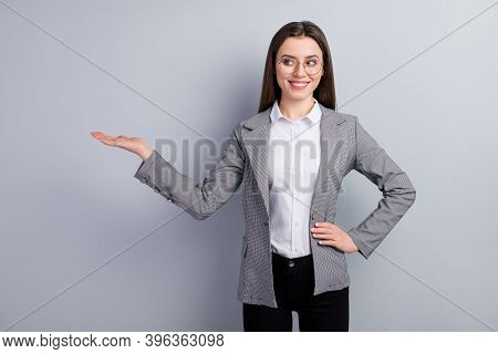 Photo Of Attractive Business Lady Manager Worker Hold Open Arm Empty Space Showing Novelty Sale Pric