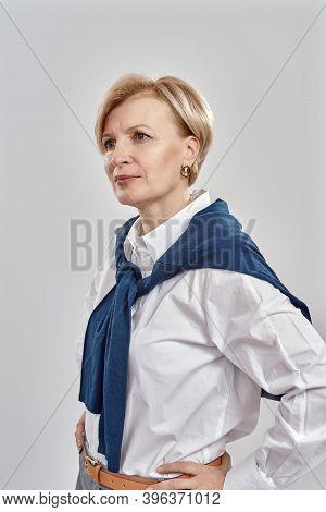 Portrait Of Elegant Middle Aged Caucasian Woman Wearing Business Attire Having A Serious, Confident
