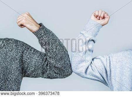 Closeup Elbow Bump. Two People Bump Elbows To Avoid Coronavirus. Coronavirus Epidemic. Elbows Bump.