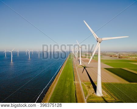 Windmill Park In The Netherlands Ocean, Windmill Farm With Huge Turbines Green Energy In The Netherl