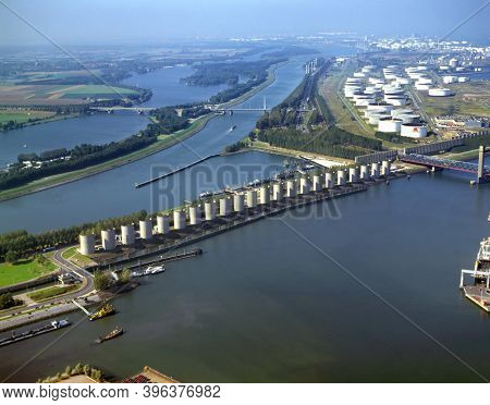 Rotterdam, Europoort, Holland, July 10 - 1997: Historical aerial photo of windscreen along the Caland canal to the Caland bridge designed by Maarten Struijs and Frans de Wit