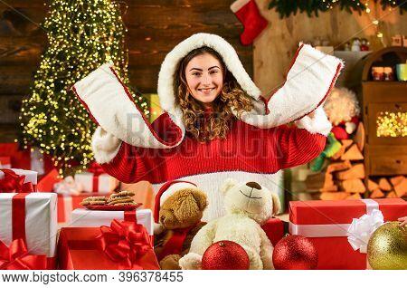 Decorate Home. Xmas Spirit. Santa Is Near. Happy Girl At Christmas Tree. Family Holiday Celebration.