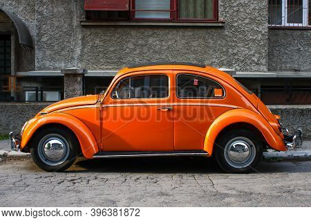 Bucharest, Romania - April 20, 2009: Orange Vintage Volkswagen Beetle Car On A Street In Bucharest.