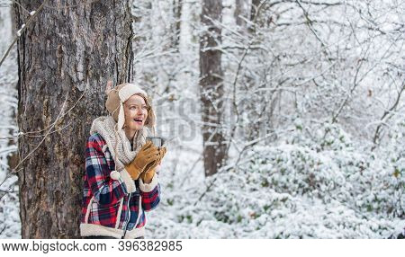 Warm Yourself Up. Woman Winter Drink. Girl Enjoy Mulled Wine. Woman In Hat Drinking Tea In Forest. H