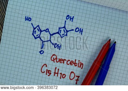 Quercetin Write On A Book. Structural Chemical Formula. Education Concept