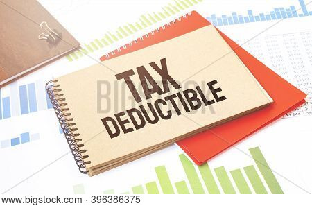 Notepad With Text Tax Deductible. Diagram, Red Notepad And White Background