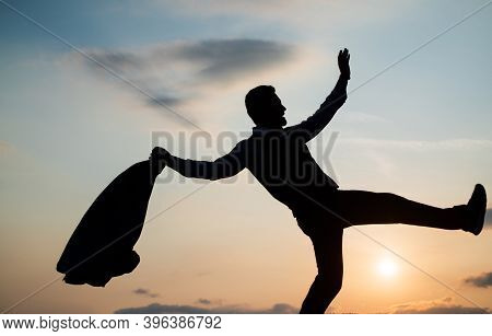 Live Your Life. Personal Achievement Goal. Man Silhouette Jump On Sky Background. Confident Business