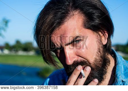 Brutal Smoker. Brutal Caucasian Hipster With Moustache Smoking Cigarette. Confident Handsome Guy Spr