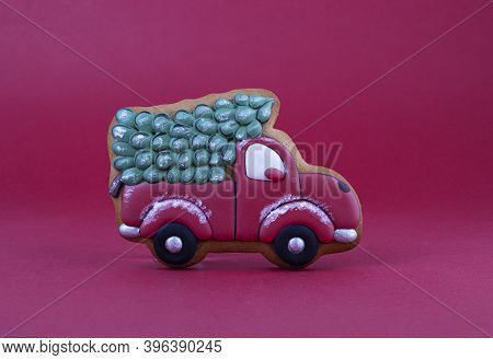 Gingerbread Car With A Christmas Tree On A Red Velvet Background. Christmas Gingerbread Cookies