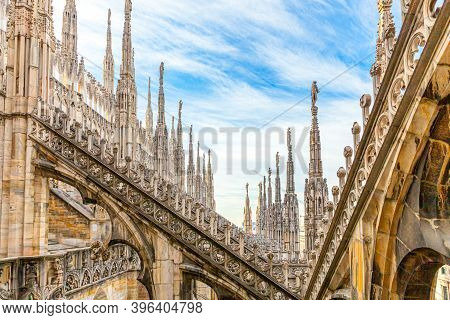 Roof Of Milan Cathedral Duomo Di Milano With Gothic Spires And White Marble Statues. Top Tourist Att