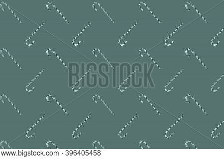 Traditional Christmas Candy Cane On Green Background
