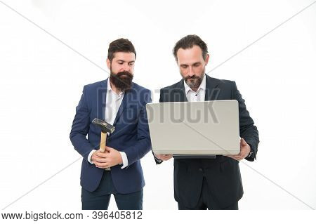 Men With Laptop And Hammer. Breakdown And Malfunction. Lags Annoy Them. Internet Connection Failure.