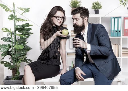 Want Some. Sexy Woman Treat Bearded Man To Apple. Business Couple Have Snack Break In Office. Health